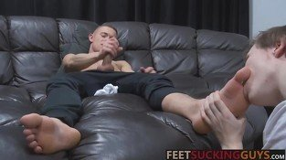 He works his cock while Kyle licks his sexy feet and toes