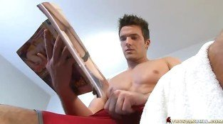 Muscled gay hunk doing a handjob in the gym