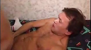 Atractive gay couple having bareback sex on bed