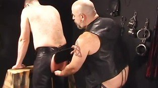 Gay in leather tortured by fat master