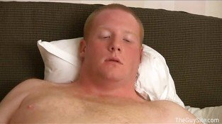 Chubby gay hunk masturbates on the bed