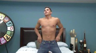 Muscled gay porn star doing a striptease