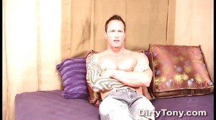 Strong tattooed gay hunk jerks off his fat meat pole