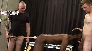 black dude tied to bench slave